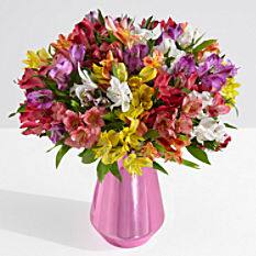 One dozen long stemmed roses + vase + chocolates = $12 delivered (other options available)