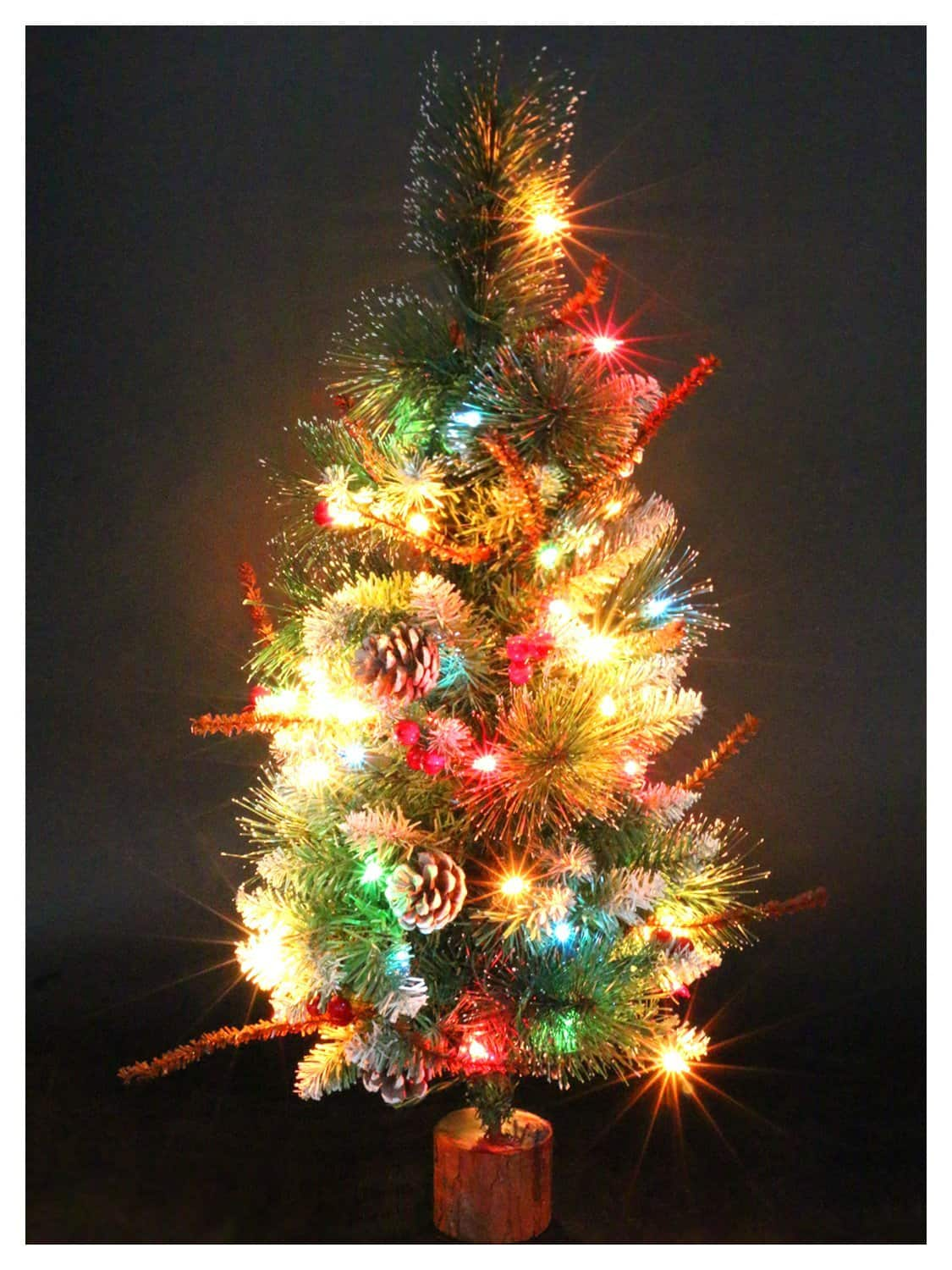 Artificial Christmas Tree on Wood Base with Ornaments and Pre-Lit Multi-Colored Lights $16