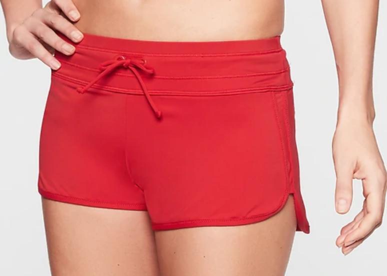 Athleta Swimwear: Surge Shorts (red) $20, Leopard High Neck Tankini $25 & More + Free Shipping on $25+ $19