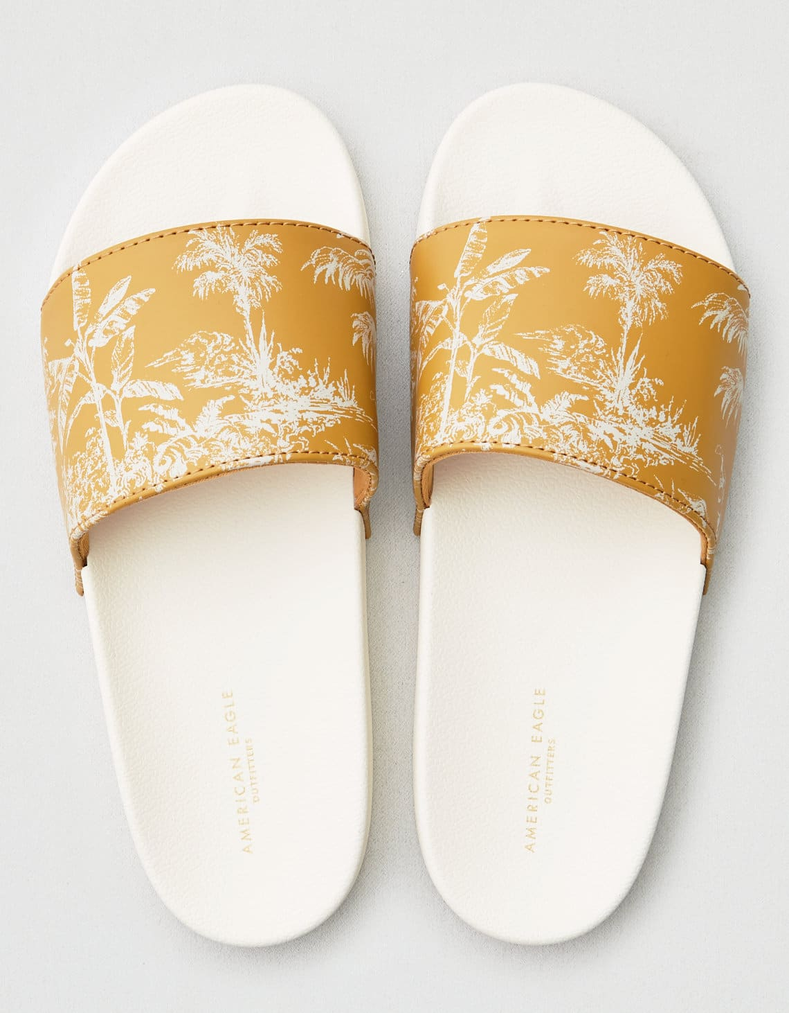 American Eagle Outfitters Women's Floral Pool Slide Sandals (mustard) $6, AEO Lace-Up Pointed Toe Flats (black, blush) $13.10 & More + FS  on $25+