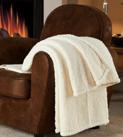 """50"""" x 60"""" Victoria Classics Fireside Sherpa Throw (ivory) $9, 50"""" x 70"""" Juicy Couture Plush Throw Blanket (various) $12 + 6% Slickdeals Cashback + Free S/H on $25+"""