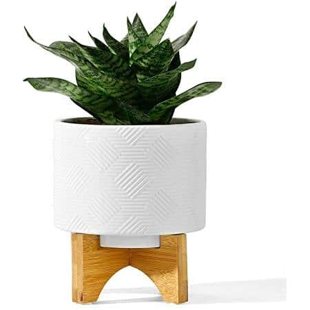 POTEY 5.2 Inch White Ceramic Planter with Wood Stand for $14.94 + Free Shipping w/Prime