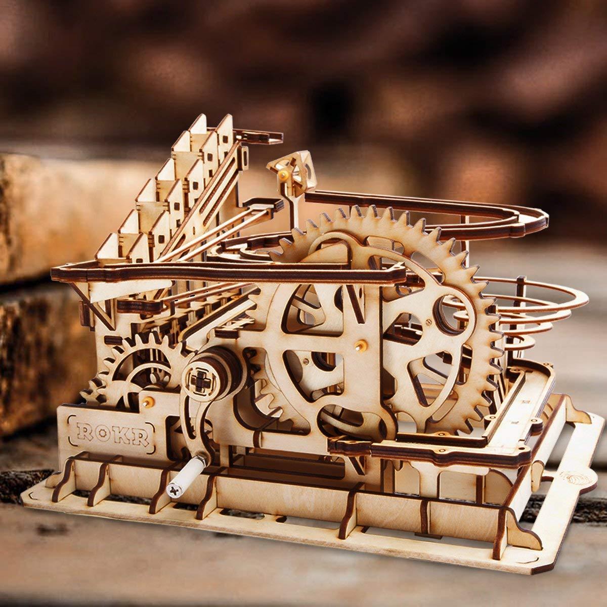 ROBOTIME DIY 3D Wooden Walking Dinosaur Puzzle Sound Control $12; Dollhouse Wooden Miniature Furniture Kit Mini Green House with LED $24.49; Waterwheel Coaster w/Steel Balls $29.66