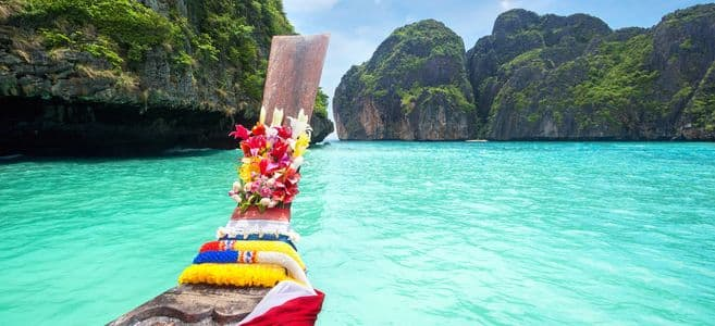 Six nights in a 4 star beach hotel in Phuket Thailand, with round-trip flights from LA or NY & airport shuttle for $715.
