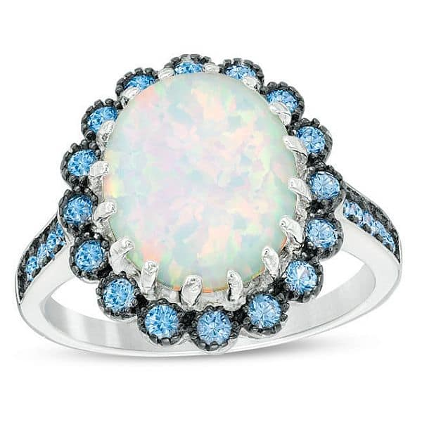Zales: Oval Lab-Created Opal and Blue Ring in Sterling Silver: $31.99 + Free Ship To Store