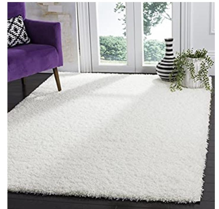 "Amazon has Safavieh Laguna Shag Collection SGL303W White Area Rug (5'3"" x 7'6"") for $57.59"