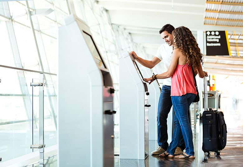 Couple checking in at airport