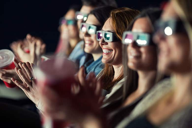People watching a movie with 3D glasses.