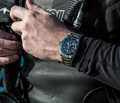 Scuba diver wearing a dive watch