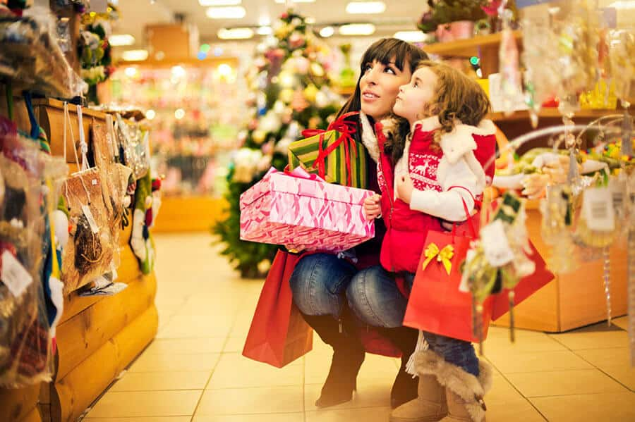 Mom and daughter shopping for Christmas presents.